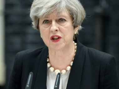 Britain's Prime Minister Theresa May, addresses the media in Downing Street, London, Tuesday May 23, 2017, the day after an apparent suicide bomber attacked an Ariana Grande concert as it ended Monday night, killing over a dozen of people among a panicked crowd of young concertgoers.