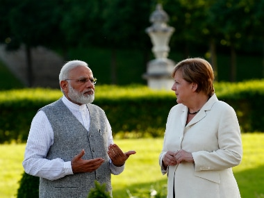 Prime Minister Narendra Modi talks to Merkel at Meseberg Palace in Meseberg, Germany. Reuters