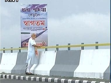 PM Modi inaugurating the Dhola-Sadiya Bridge. Courtesy: Twitter/@ANI