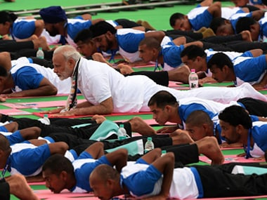 Prime Minister Narendra Modi participates in a mass yoga session on Internal Yoga Day in 2016. Getty Images