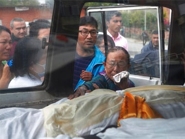 Relatives of the deceased crew members react after  the bodies were loaded in an ambulance in Kathmandu, Nepal. AP