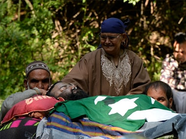 A Kashmiri woman mourns during the funeral procession of Hizbul commander Sabzar Ahmad Bhat in Rathsuna Tral, near Srinagar. Getty Images