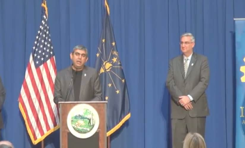 Infosys' Vishal Sikka and Indiana Governor Eric Holcomb in Indianapolis Tuesday/ Youtube