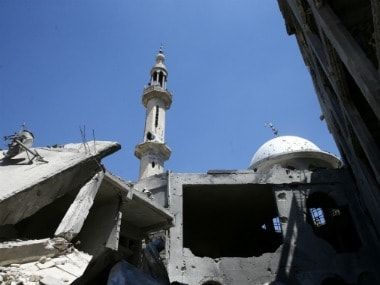A damaged mosque is seen in the rebel held besieged eastern Damascus suburb of Ghouta. Reuters