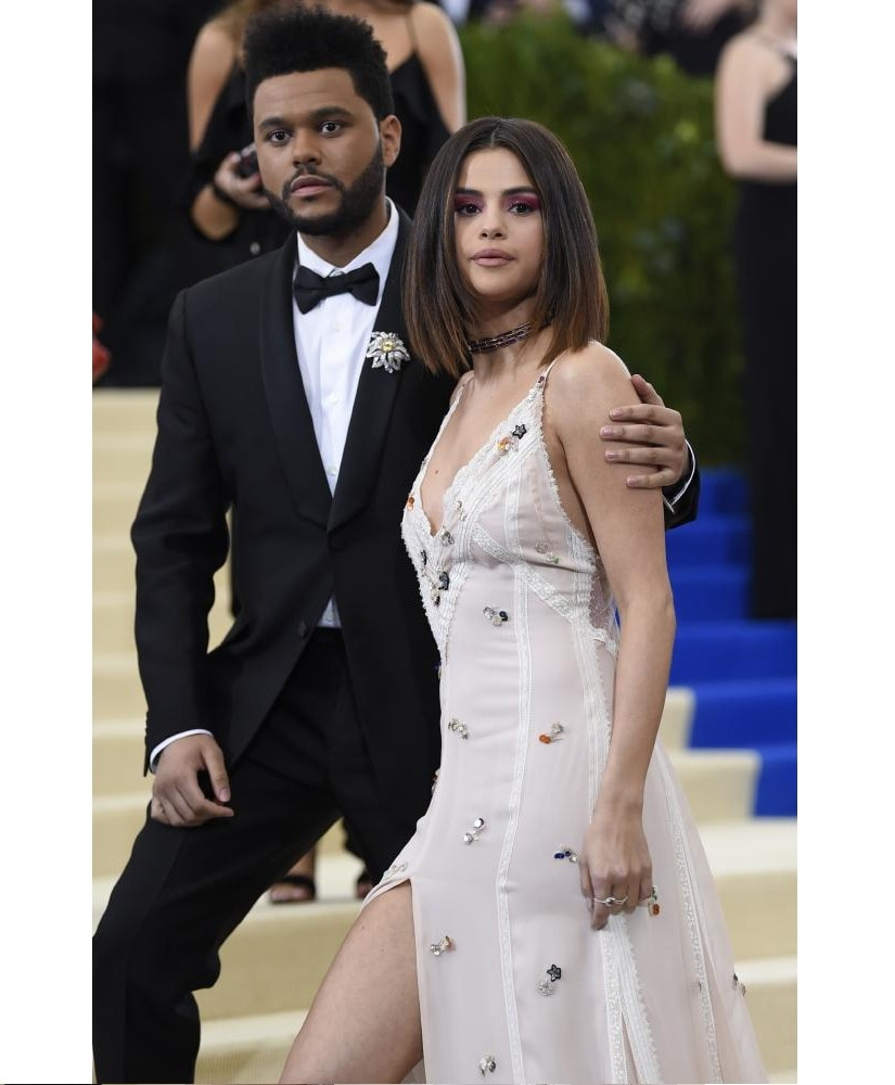 The Weeknd and Selena Gomez. Photo by Getty Images.