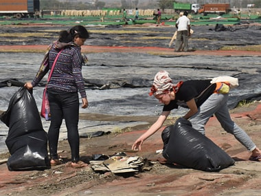Volunteers cleaning the area after the World Culture Festival organised by the Art of Living in March 2016. Getty Images