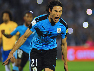 Uruguay's Edinson Cavani celebrates after scoring against Brazil during their 2018 FIFA World Cup qualifier football match in Montevideo, Uruguay, on March 23, 2017. / AFP PHOTO / DANTE FERNANDEZ