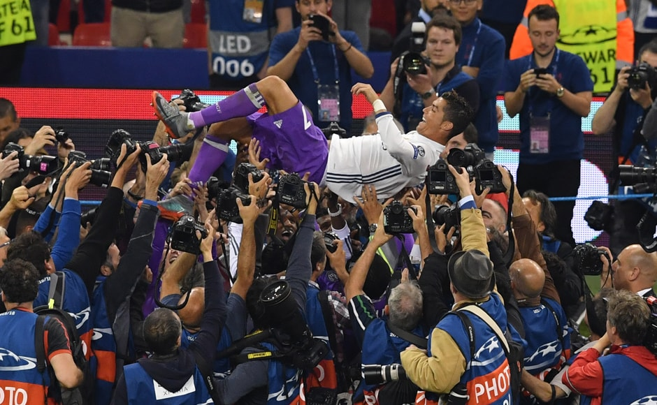 Real Madrid's Portuguese striker Cristiano Ronaldo celebrates after winning the UEFA Champions League final football match between Juventus and Real Madrid at The Principality Stadium in Cardiff. AFP