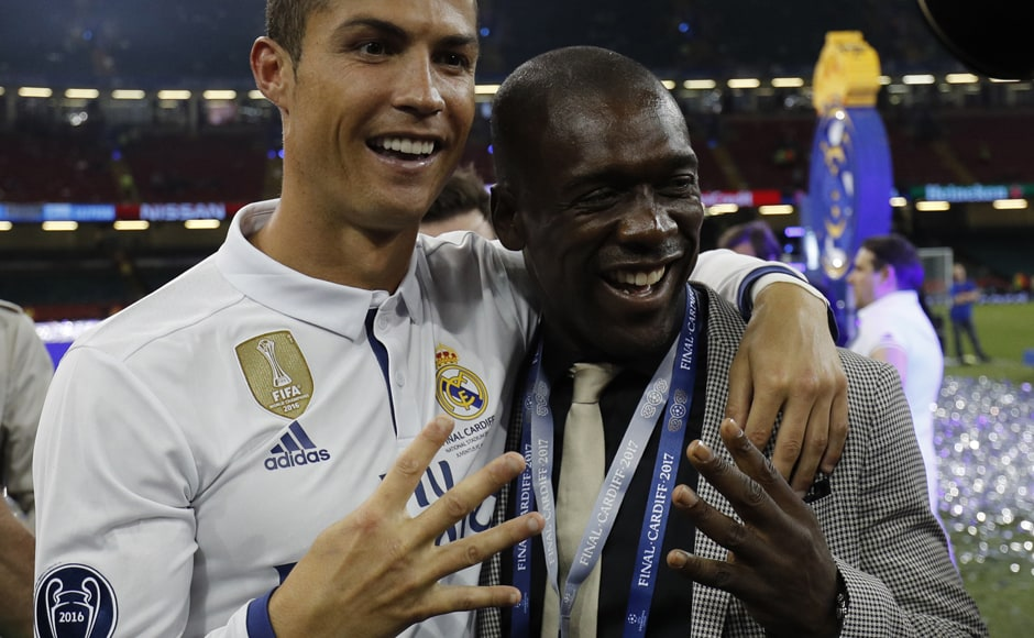 Real Madrid's Cristiano Ronaldo with former AC Milan, Real Maddrid and Ajax midfielder Clarence Seedorf. Both players have won the Champions League four times. AFP