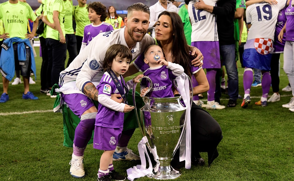 Real Madrid captain Sergio Ramos, his wife Pilar Rubio and their sons Sergio and Marco pose with the trophy after Real Madrid won the UEFA Champions League. AFP