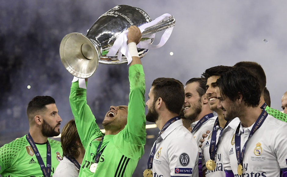 Real Madrid's Costa Rican goalkeeper Keylor Navas (2nd-L) lifts the trophy after Real Madrid won the UEFA Champions League with 4-1 win over Juventus in Cardiff. AFP