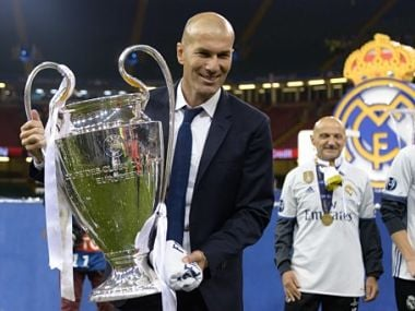 Real Madrid's French coach Zinedine Zidane lifts the trophy after Real Madrid won the UEFA Champions League final football match between Juventus and Real Madrid at The Principality Stadium in Cardiff, south Wales, on June 3, 2017. / AFP PHOTO / Filippo MONTEFORTE