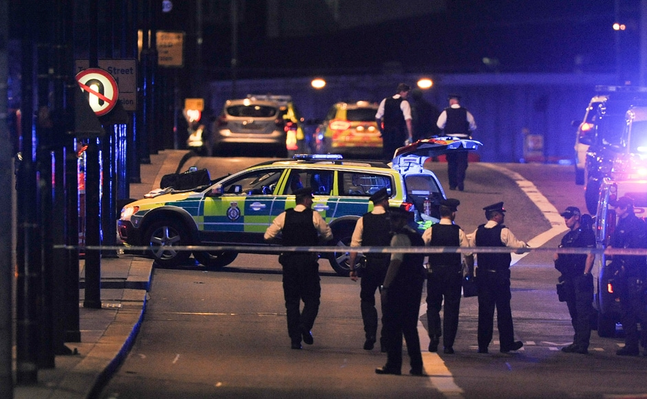 Police officers gather at the scene of the attack on Saturday. AFP