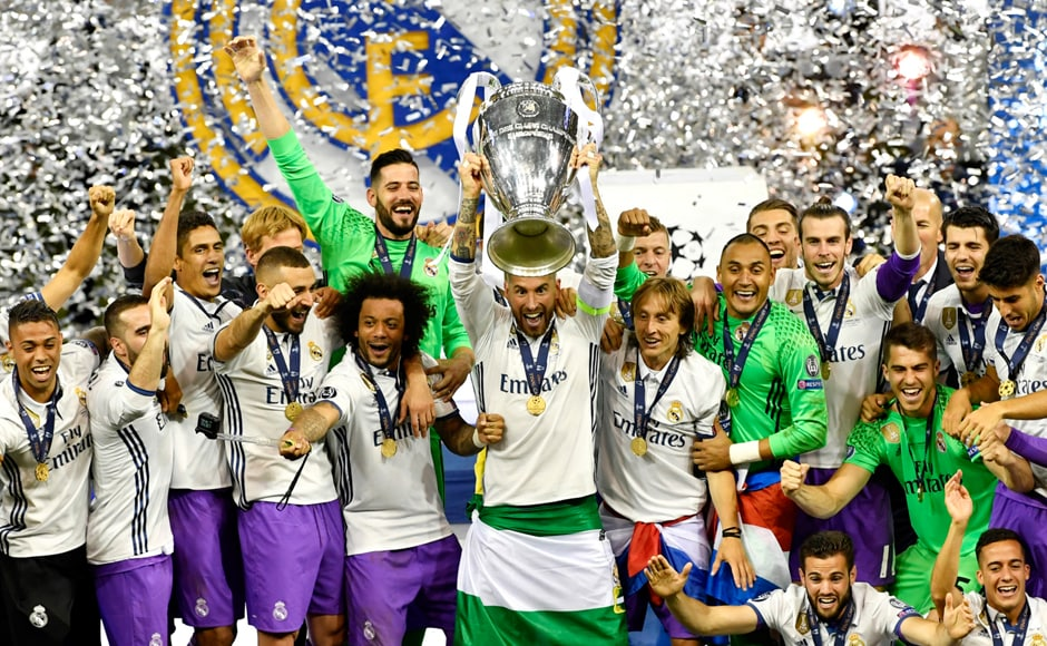 Sergio Ramos of Real Madrid lifts the trophy after winning the UEFA Champions League final against Juventus at The Principality Stadium in Cardiff.  AFP