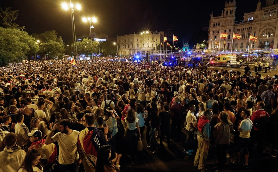 Real Madrid fans celebrating their team's triumph in Madrid. AFP