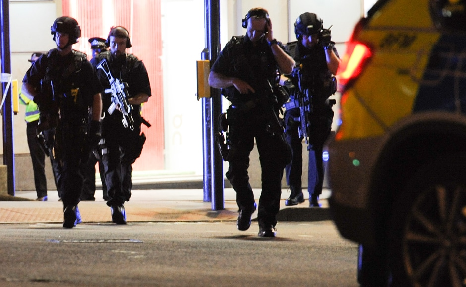 Armed police take position at the scene of the attack at London Bridge on Saturday. Police fired shots after reports of an incident reminiscent of a terror attack in March just five days ahead of the general elections, killing the three suspects. AFP