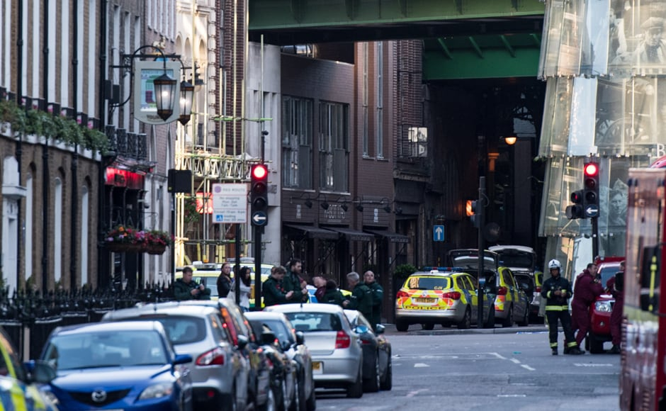 Police officers and emergency response vehicles gather on the street outside Borough Market on Sunday morning after a terror attack on London Bridge and the Borough area in London. Six people have been reportedly killed and three terror suspects shot dead by police following the attack on Saturday evening. AFP