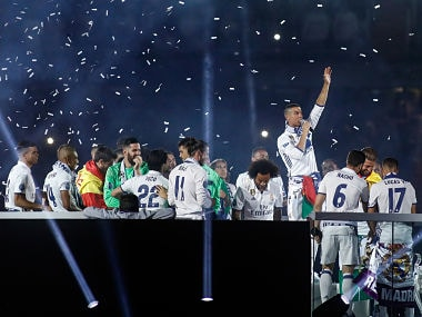 Real Madrid's Portuguese forward Cristiano Ronaldo (C) speaks as he celebrates with teammates the team's win, at the Santiago Bernabeu stadium in Madrid on June 4, 2017 after winning the UEFA Champions League. AFP