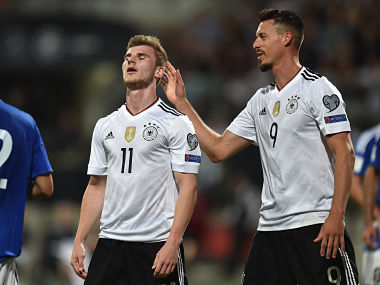 Germany's midfielder Sandro Wagner (R) reacts with his teammate Germany's midfielder Timo Werner (L) during the WC 2018 qualification match between Germany and San Marino in the stadium in Nuremberg, southern Germany, on June 10, 2017. / AFP PHOTO / Christof STACHE