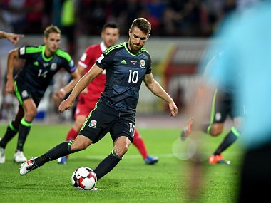 World Cup qualifiers: Wales gain point at Serbia; Spain Italy notch up easy wins