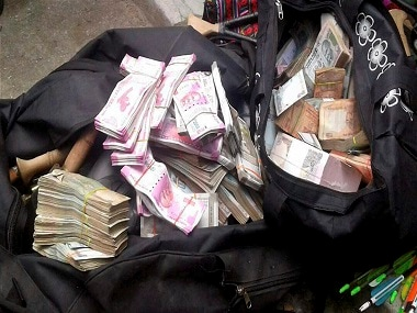 Police has also seized large amounts of cash  from the raids. PTI