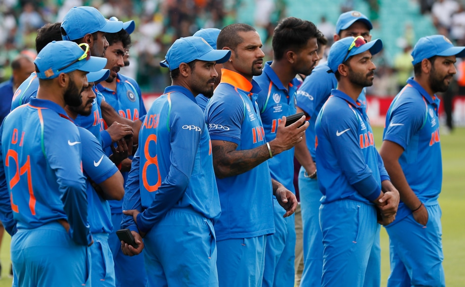 India's players look on as Pakistan team celebrate their win after the match.AP