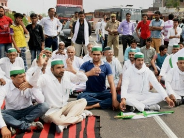 Bharatiya Kisan Union members perform Yoga on National Highway 58 as part of their symbolic protest against the government. PTI