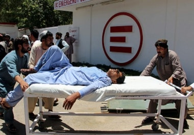 A man is transported to a hospital after a car bomb attack in Lashkar Gah. Reuters