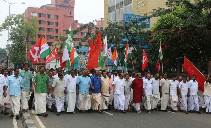 Kerala finance minister Thomas Isaac leading a LDF protest rally. Firstpost/Ashraf Padanna