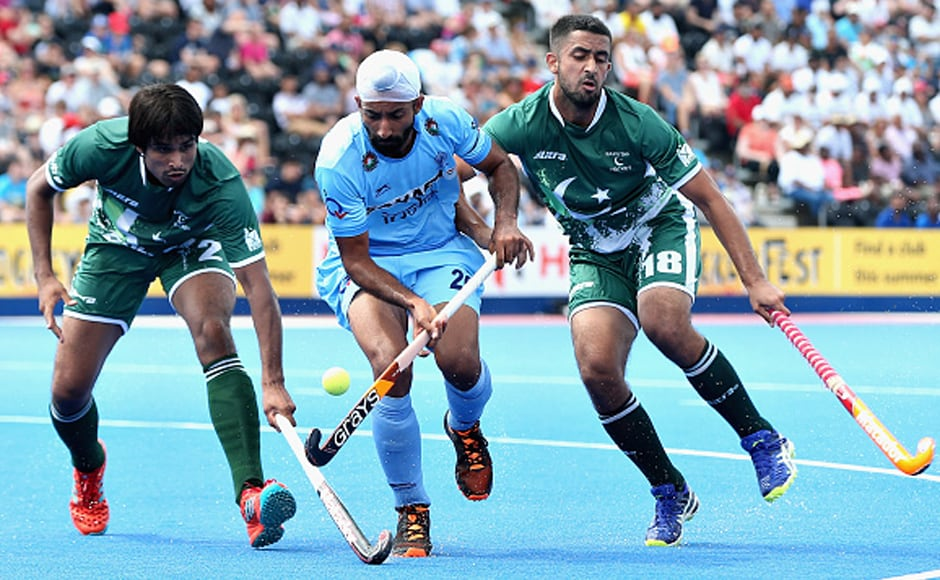 Talwinder Singh of tangles with Muhammad Aleem Bilal and Muhammad Yaqoob of Pakistan during the match on Sunday. AP
