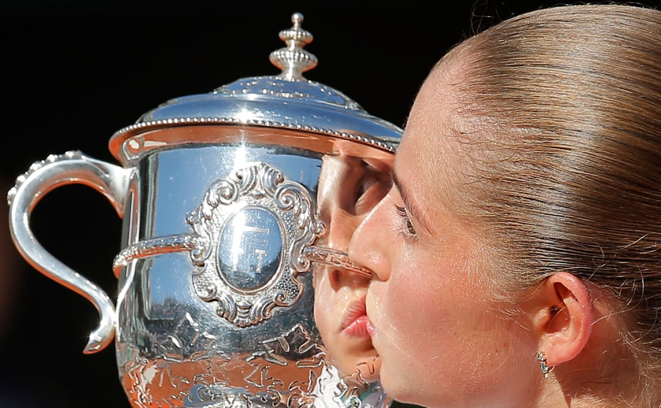 Twenty-year-old Jelena Ostapenko kisses the cup after defeating Simona Halep in the final of the French Open. AP