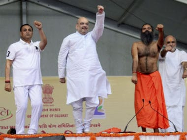 Amit Shah doing yoga with Gujarat chief minister Vijay Rupani (left) and Ramdev (right). PTI
