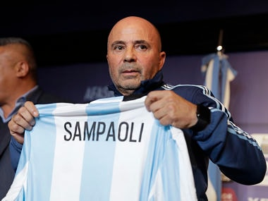 Argentina's new soccer coach Jorge Sampaoli holds up a jersey featuring his name at the end of a press conference in Buenos Aires, Argentina, Thursday, June 1, 2017. (AP Photo/Natacha Pisarenko)