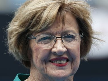"""In this Jan. 26, 2015 photo, Australian tennis great Margaret Court smiles during the official launch of the remodeled Margaret Court Arena at the Australian Open tennis championship in Melbourne. Former tennis great and now Christian pastor Court says she will stop using Qantas """"where possible"""" in protest over the Australian airline's promotion of same-sex marriage. """"I am disappointed that Qantas has become an active promoter for same-sex marriage,"""" Perth resident Court said in the letter published Thursday, May 25, 2017, in The West Australian newspaper. (AP Photo/Vincent Thian)"""