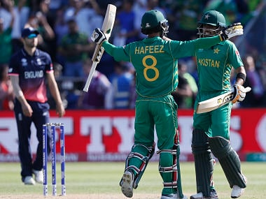 Pakistan's Mohammad Hafeez, left, and Babar Azam celebrate after scoring winning runs. AP
