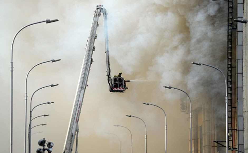 The intensity of the blaze was such that five floors collapsed after almost 24 hours since the fire broke out. Almost 60 firefighters were pressed into service to control the fire amid billowing smoke and soot. AFP