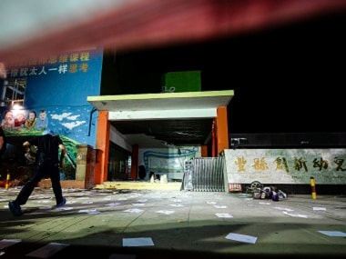 investigators at the scene of an explosion outside a kindergarten in Fengxian County in China. AP