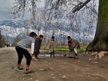 Children playing cricket in Kashmir. Getty Images