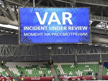 A giant screen reports a VAR incident is being reviewed during the Confederations Cup. AP