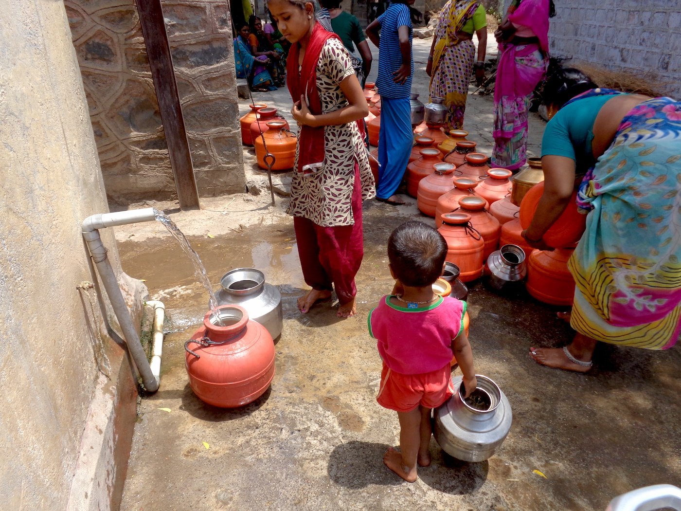 Desperate for water: children as young as five queue up with their pots in Takwiki village. Parth MN