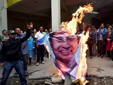 GJM supporters burn an effigy of West Bengal chief minister Mamata Banerjee in Darjeeling. PTI