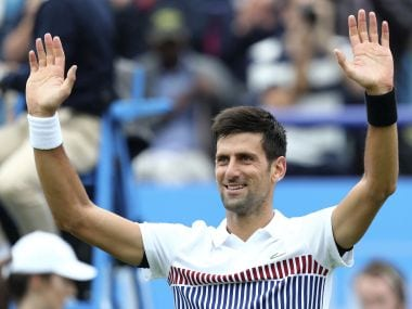 Novak Djokovic celebrates his victory over Vasek Pospisil at Eastbourne International. AP