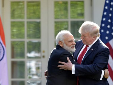 Donald Trump and Narendra Modi hug while making statements in the Rose Garden of the White House in Washington. AP