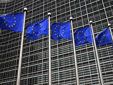 European Union flags fly in front of the European Commission headquarters in Brussels. Reuters