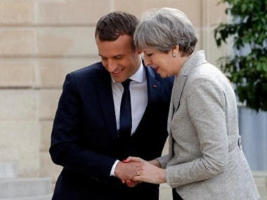 File image of French president Emmanuel Macron greeting Britain's prime minister Theresa May. Reuters