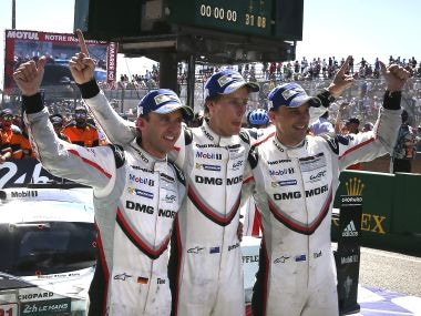 Drivers of the Porsche 919 Hybrid No 2, from left to right, Brendon Hartley Earl Bamber and Timo Bernhard after winning the race. AP