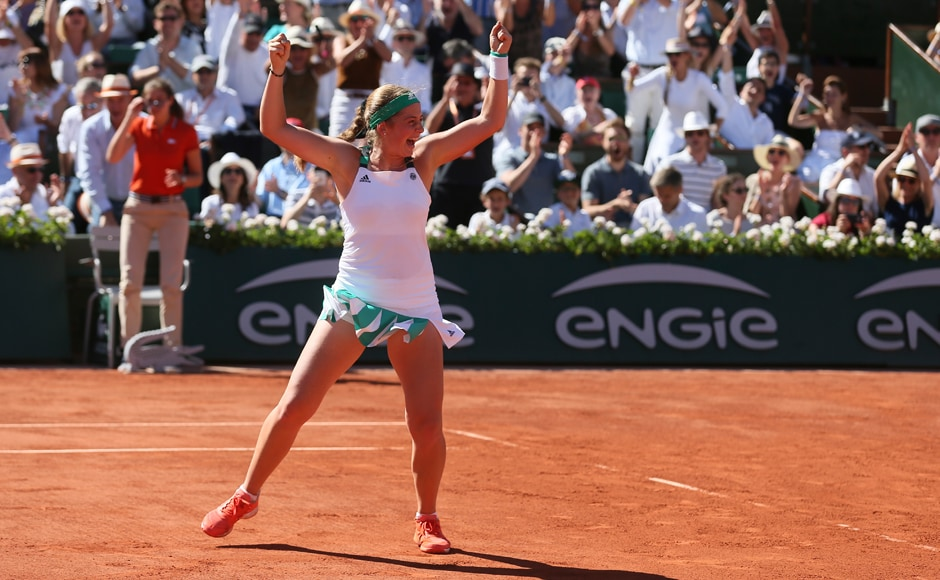 WHAT. A. MOMENT! Ostapenko jumps after defeating Halep in three sets in the finalof women's singles at the French Open.AP