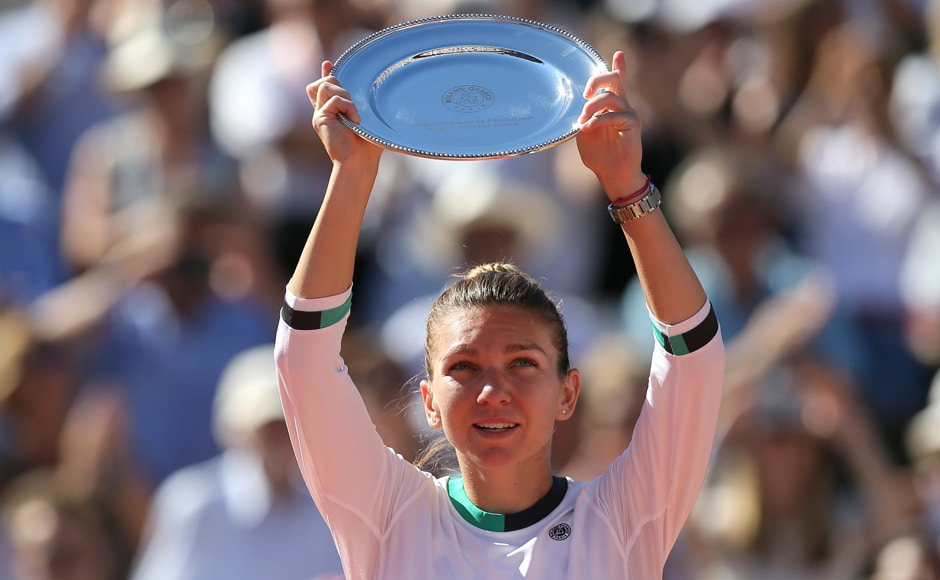 Halep holds her plate after losing to Ostapenko in three games. AP