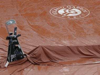 Philippe-Chatrier Court covered by a tarp during a downpour at Roland Garros. AFP