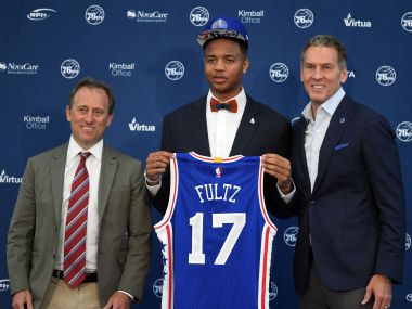 Markelle Fultz (center) poses with Philadelphia 76ers owner and general manager. Reuters